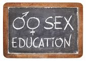 sex education title with gender symbols - white chalk on vintage slate blackboard isolated on white
