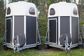 picture of trailer park  - Two horse trailers parked in the forest - JPG