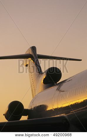 Tail fin of airplane sunse