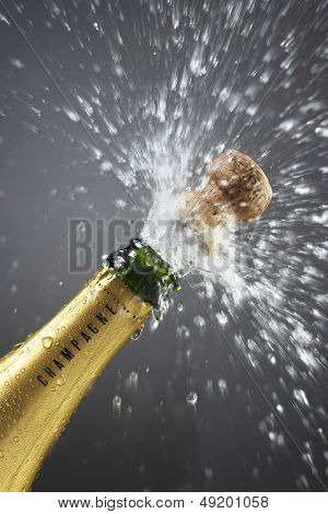 Champagne bottle popping cork close-up