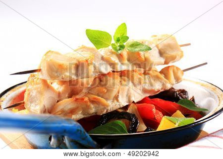 poultry skewers with vegetable side dish