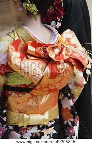 Japanese Woman in Kimono and Elaborate Obi