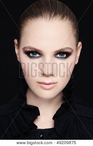 Portrait of beautiful stylish young woman with smokey eyes
