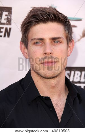 LOS ANGELES - AUG 10:  Chris Lowell at the Invisible Children Fourth Estate's Founders Party at the UCLA on August 10, 2013 in Westwood, CA