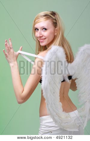 Beautiful Young Woman With White Angel Wings
