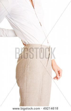 Woman with back pain holding her aching hip