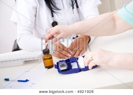 Young Doctor Check The Blood-sugar Level