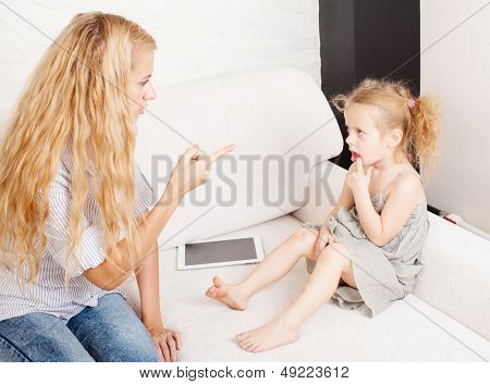 Mother scolding baby. Parent upbringing little child