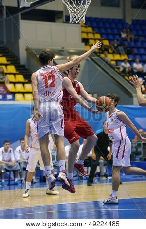 KIEV, UKRAINE - AUGUST 8: Fight under the backboard during the U16 Eurobasket  2013 First round match between Poland and Montenegro at Palace of Sport in Kiev, Ukraine on August 8, 2013