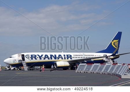 LA ROCHELLE, FRANCE - JUNE 24: People go out from the Ryanair plane in the airport of La Rochelle, France on June 24, 2013. Ryanair will carry 81.5 million passengers this year