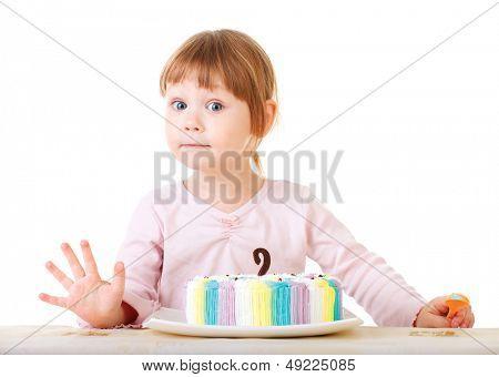 Baby girl and her birthday cake, studio