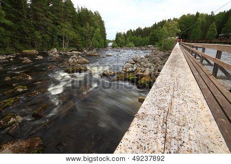 ancient fishing camp and a new log bridge