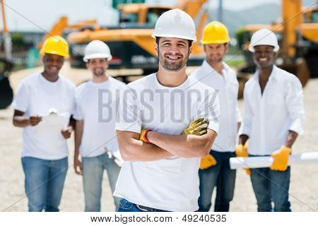 Happy group of construction workers at a building site