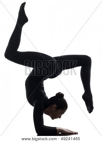 one caucasian woman contorsionist practicing gymnastic yoga  in silhouette   on white background