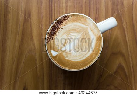 Leaf Shaped Coffee Milk Foam In White Ceramic Cup