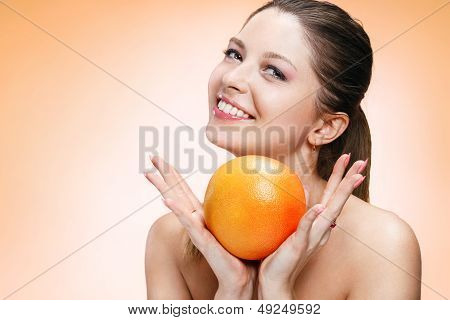 Young beautiful girl with orange
