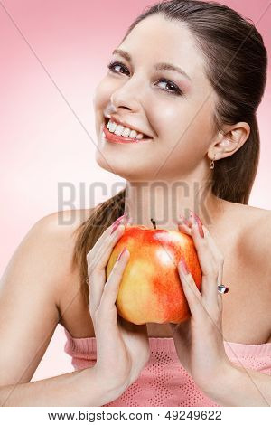 Young beautiful girl with an apple