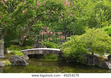Japan Himeji Himeji Koko-en Gardens stone bridge over stream