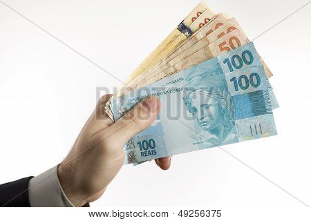 Holding A Brazilian Money.