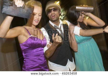 Displeased multiethnic celebrities leaving venue