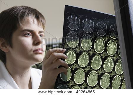 Closeup of a serious female doctor holding CAT scan