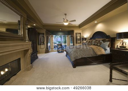 View of a spacious bedroom with dark wood furniture at home