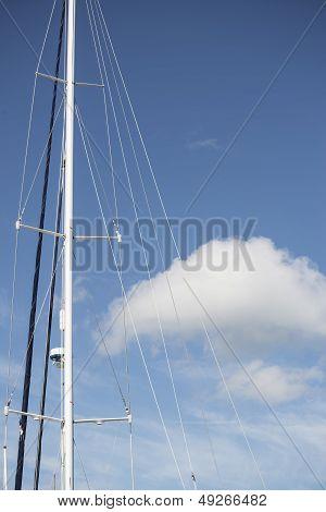 Blue Summer Sky Fluffy Cloud And Yacht Mast