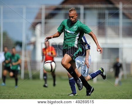 KAPOSVAR, HUNGARY - JULY 20: Unidentified players in action at the IX. Youth Football Festival under 17 match SYFA West R (blue)(SCO) vs. Rakoczi FC (green) (HUN) on July 20, 2013 in Kaposvar, Hungary