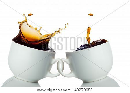 two cups of coffee creating splashes. Love symbol