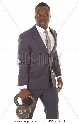 Man In Suit Stand With Weight