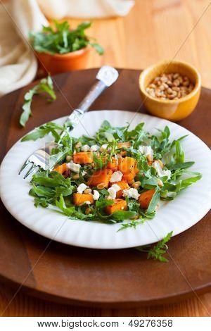pumpkin salad with feta,arugula and pine nut