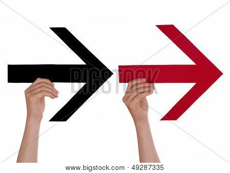 Two Hands Holding Arrows