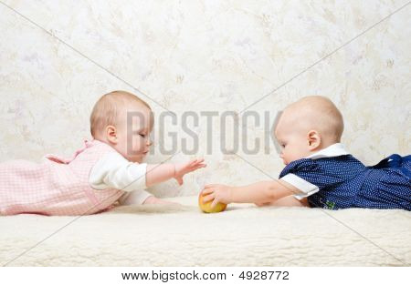 Two Infants With Apple