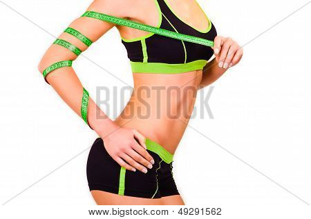 Figure of girl is in a sports wear with a centimetre ribbon on a hand