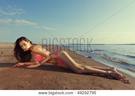 sexy woman lies on beach