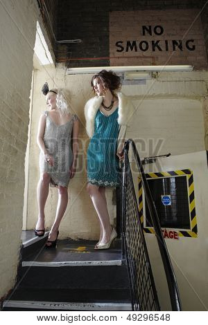 Full length of two beautiful young women waiting backstage