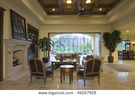 Spacious living room with view of porch and dining area in background at home