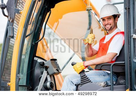 Crane operator at a construction site looking happy