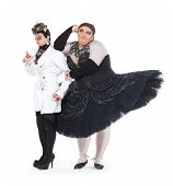 stock photo of drag-queen  - Two drag queens performing together in humorous caricature of women on white - JPG
