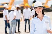 stock photo of real-estate-team  - Female architect at a construction site looking happy - JPG
