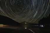 stock photo of perseus  - Star Trails Over Mount Hood at Trillium Lake Oregon with Reflection at Night - JPG