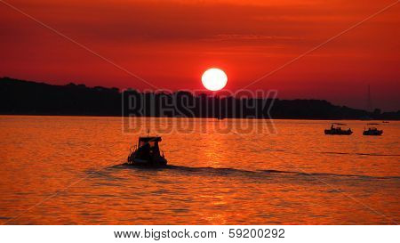 Fishermen On Sea At Red Sunset