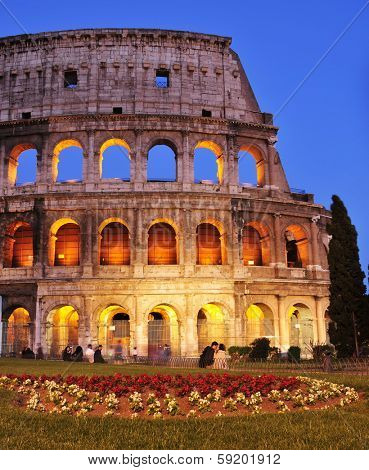 ROME, ITALY - APRIL 17: The Coliseum at twilight on April 17, 2013 in Rome, Italy. The Coliseum is an iconic symbol of Rome and one of the most popular tourist attractions in the city