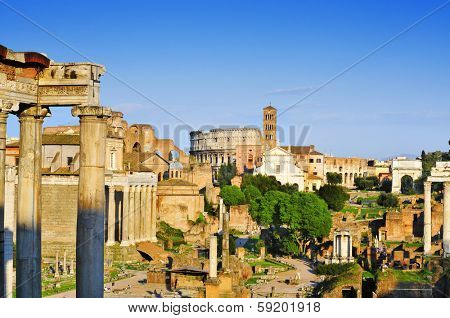 ROME, ITALY - APRIL 17: Roman Forum with the Coliseum in the background on April 17, 2013 in Rome, Italy. The Coliseum is an iconic symbol of Rome and one of its most popular tourist attractions