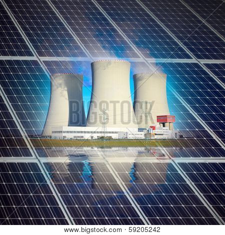 Solar panels and nuclear power plant. Sustainable development and renewable resources concept.