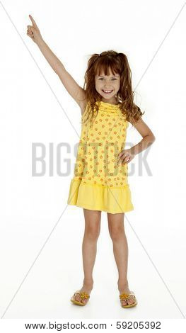 Full length photo of cute little girl pointing upward on white background