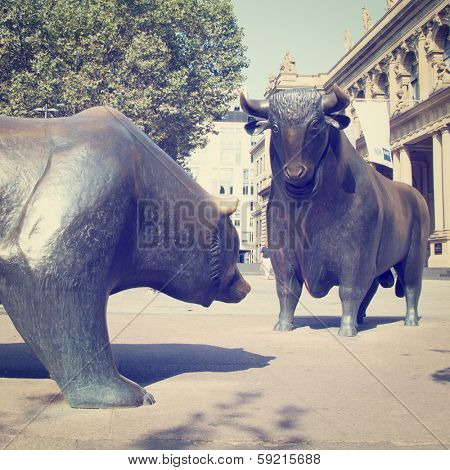 A Bull and Bear Statues in public area with retro effect.