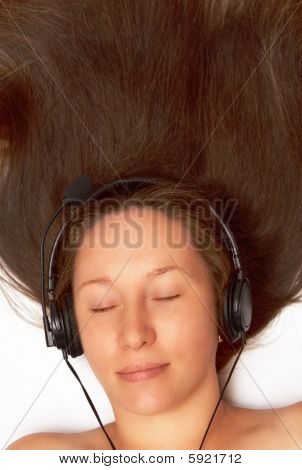 Woman Listens To Music