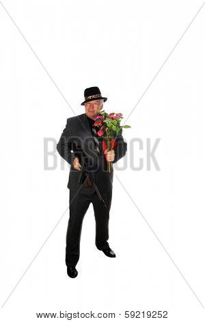 A 1920's era gangster in a pin stripe suit holds his machine Gun while isolated on white with room for your text