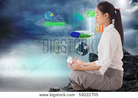 Businesswoman sitting in lotus pose against global technology background, elements of this image furnished by NASA